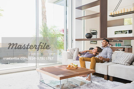 Couple relaxing together on sitting room sofa Stock Photo - Premium Royalty-Free, Image code: 614-07805767