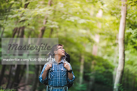 Hiker with backpack in forest
