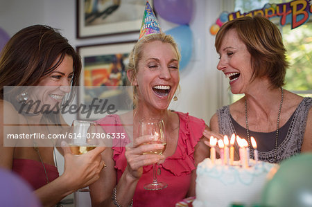 Three mature women at birthday party, laughing Stock Photo - Premium Royalty-Free, Image code: 614-07806335