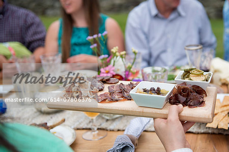 Family having meal together, outdoors Stock Photo - Premium Royalty-Free, Image code: 614-07806376
