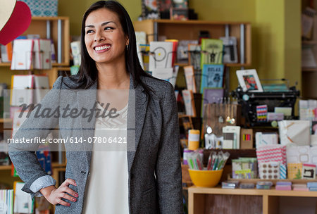 Portrait of female sales assistant in stationery shop Stock Photo - Premium Royalty-Free, Image code: 614-07806421