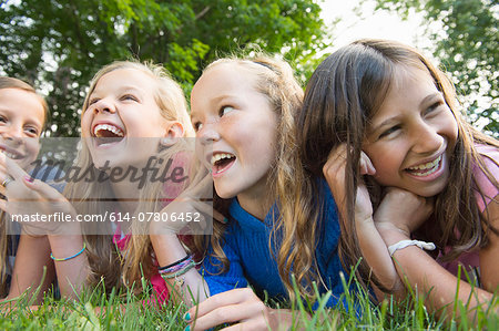 Friends lying on grass Stock Photo - Premium Royalty-Free, Image code: 614-07806452