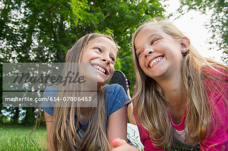 Friends lying on grass Stock Photo - Premium Royalty-Free, Image code: 614-07806453