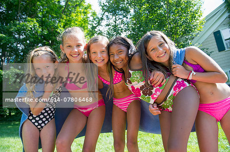 Girls in swimming costume wrapped in towel Stock Photo - Premium Royalty-Free, Image code: 614-07806468