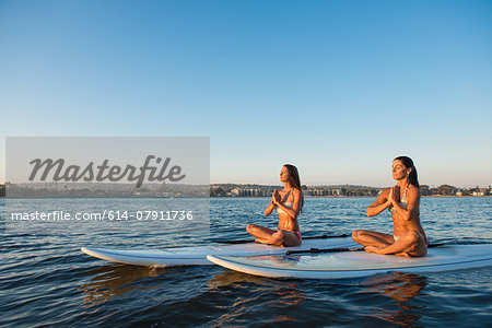 Two women in lotus position on paddleboards, Mission Bay, San Diego, California, USA Stock Photo - Premium Royalty-Free, Image code: 614-07911736