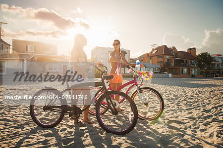Two women cyclists chatting on beach, Mission Bay, San Diego, California, USA Stock Photo - Premium Royalty-Free, Image code: 614-07911746