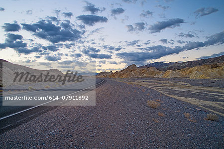 Roadside view of highway 190 at dawn, Death Valley National Park, California, USA Stock Photo - Premium Royalty-Free, Image code: 614-07911892