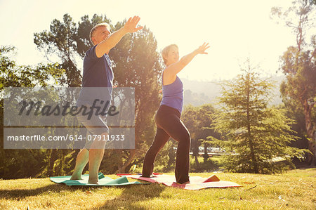 Mature couple practicing yoga position in park Stock Photo - Premium Royalty-Free, Image code: 614-07911933