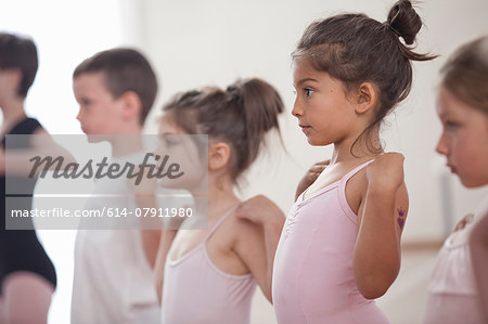Row of children practicing in ballet school Stock Photo - Premium Royalty-Free, Image code: 614-07911980