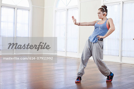 Teenage girl warming up with alternative dance in ballet school Stock Photo - Premium Royalty-Free, Image code: 614-07911992