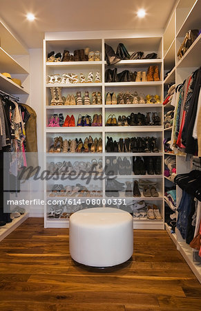 Luxury walk in closet with storage for shoes and clothing Stock Photo - Premium Royalty-Free, Image code: 614-08000331