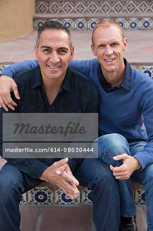 Portrait of mature male couple sitting on stairs in park Stock Photo - Premium Royalty-Free, Image code: 614-08030444