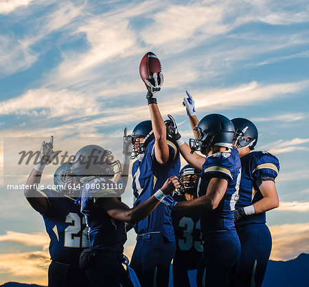 Teenage and young male american football team celebrating together Stock Photo - Premium Royalty-Free, Image code: 614-08031110