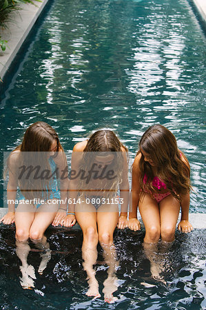 Three girls paddling in swimming pool Stock Photo - Premium Royalty-Free, Image code: 614-08031153