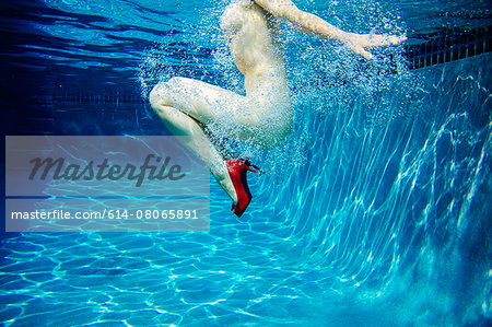 Mature woman, nude, wearing only red high heels, underwater view, low section Stock Photo - Premium Royalty-Free, Image code: 614-08065891
