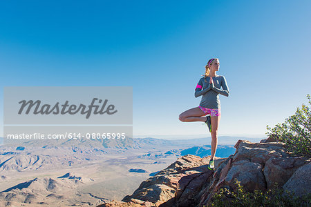 Young female trail runner doing yoga pose on Pacific Crest Trail, Pine Valley, California, USA Stock Photo - Premium Royalty-Free, Image code: 614-08065995