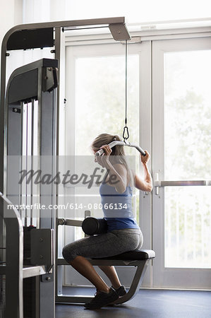 Mature woman training on gym machine Stock Photo - Premium Royalty-Free, Image code: 614-08066134