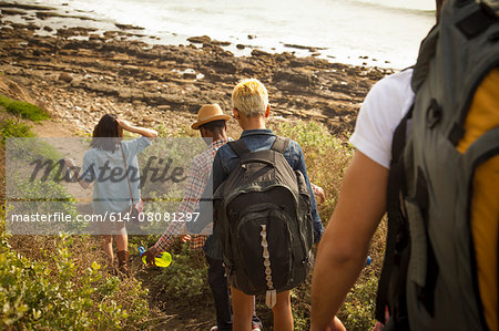Group of friends walking down towards beach, rear view Stock Photo - Premium Royalty-Free, Image code: 614-08081297