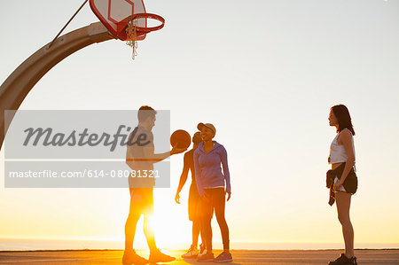 Group of friends playing basketball, outdoors Stock Photo - Premium Royalty-Free, Image code: 614-08081321