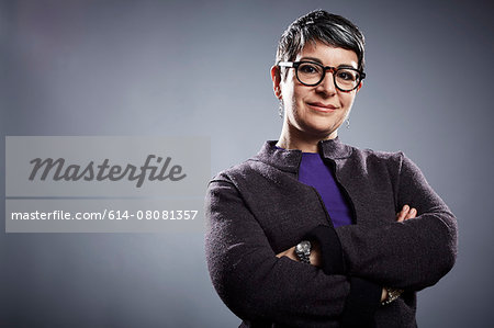 Studio portrait of mature businesswoman with arms folded Stock Photo - Premium Royalty-Free, Image code: 614-08081357