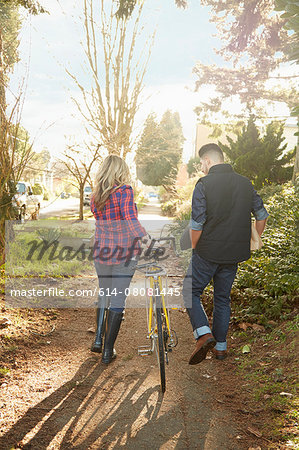 Young couple on path with bicycle Stock Photo - Premium Royalty-Free, Image code: 614-08081445