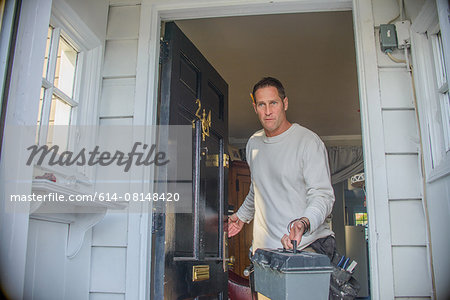 Handyman leaving house Stock Photo - Premium Royalty-Free, Image code: 614-08148420