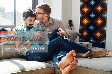 Male couple relaxing on sofa together Stock Photo - Premium Royalty-Free, Image code: 614-08148655