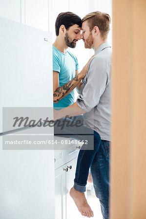 Male couple in kitchen, face to face, embracing Stock Photo - Premium Royalty-Free, Image code: 614-08148662