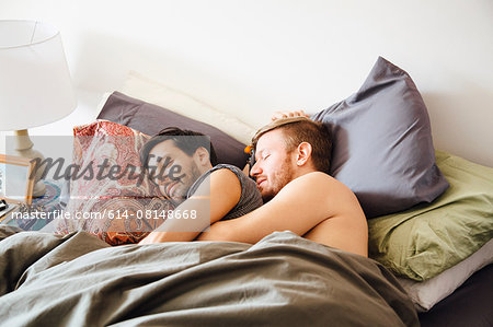 Male couple in bed, hugging whilst sleeping Stock Photo - Premium Royalty-Free, Image code: 614-08148668