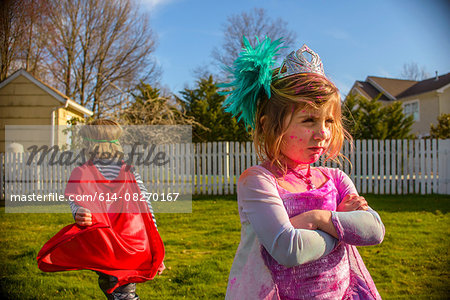 Children in costumes sulking after fight Stock Photo - Premium Royalty-Free, Image code: 614-08270167