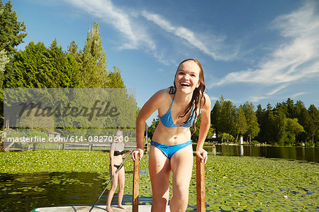 Girls in bikini having fun at lake, Seattle, Washington, USA Stock Photo - Premium Royalty-Free, Image code: 614-08270200