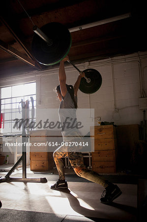 Crossfitter lifting barbell in gym Stock Photo - Premium Royalty-Free, Image code: 614-08270414
