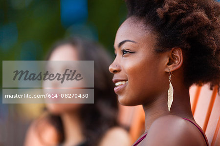 Young women relaxing on deck chair Stock Photo - Premium Royalty-Free, Image code: 614-08270430