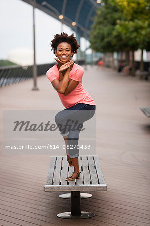 Young woman twisting and balancing on one leg Stock Photo - Premium Royalty-Free, Image code: 614-08270433
