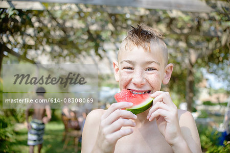 Boy enjoying watermelon at tomato eating festival Stock Photo - Premium Royalty-Free, Image code: 614-08308069