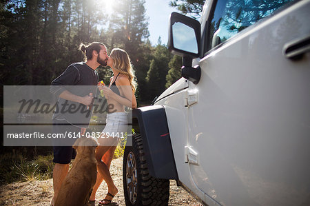 Romantic young couple kissing on riverside, Lake Tahoe, Nevada, USA Stock Photo - Premium Royalty-Free, Image code: 614-08329441