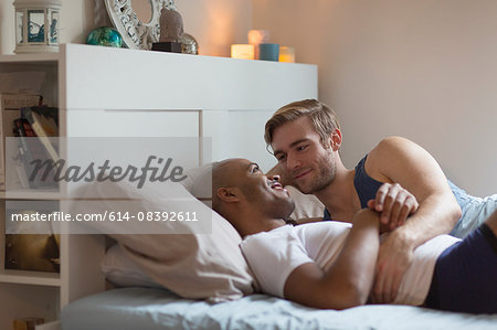 Male couple lying in bed together, face to face Stock Photo - Premium Royalty-Free, Image code: 614-08392611