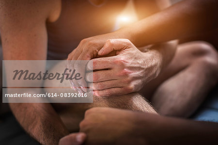 Male couple sitting together, holding hands, mid section Stock Photo - Premium Royalty-Free, Image code: 614-08392616