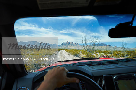 Man driving off road vehicle along dirt track, Big Bend National Park, Texas, USA Stock Photo - Premium Royalty-Free, Image code: 614-08720977