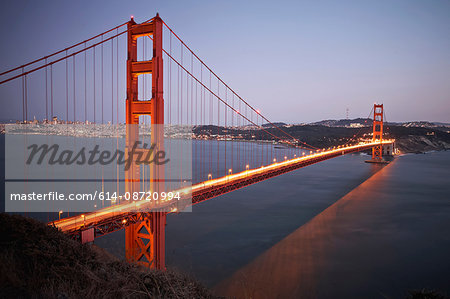 View of traffic light trails crossing Golden Gate Bridge at dusk, San Francisco, California,  USA Stock Photo - Premium Royalty-Free, Image code: 614-08720994