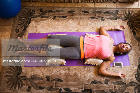 Overhead view of woman lying down meditating Stock Photo - Premium Royalty-Free, Image code: 614-08721059