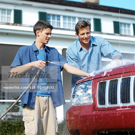 portrait of a father and son washing the car together Stock Photo - Premium Royalty-Free, Image code: 618-00459192