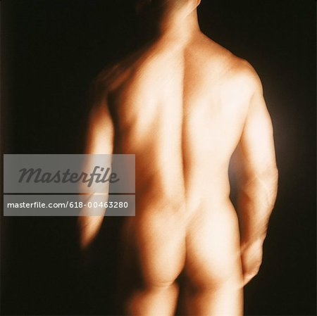 rear view blurred shot of a nude man standing Stock Photo - Premium Royalty-Free, Image code: 618-00463280