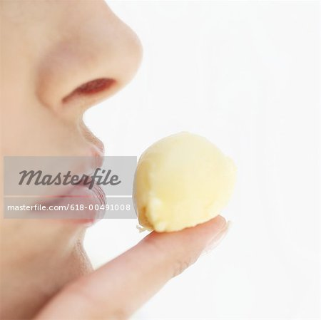 close-up of a young woman's finger with a blob of butter Stock Photo - Premium Royalty-Free, Image code: 618-00491008