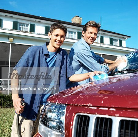 Portrait of a father and teenage son (18-20) washing the car Stock Photo - Premium Royalty-Free, Image code: 618-00499949