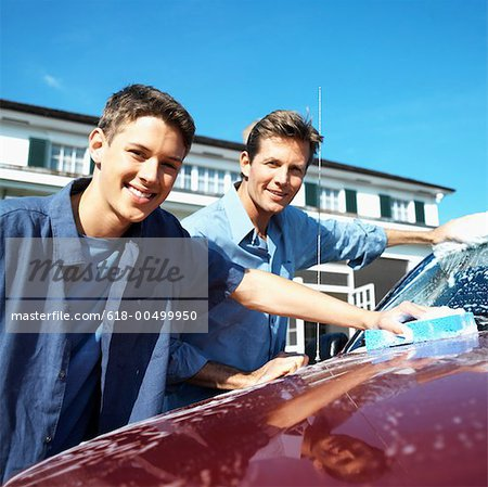 Portrait of a father and teenage son (18-20) washing the car Stock Photo - Premium Royalty-Free, Image code: 618-00499950