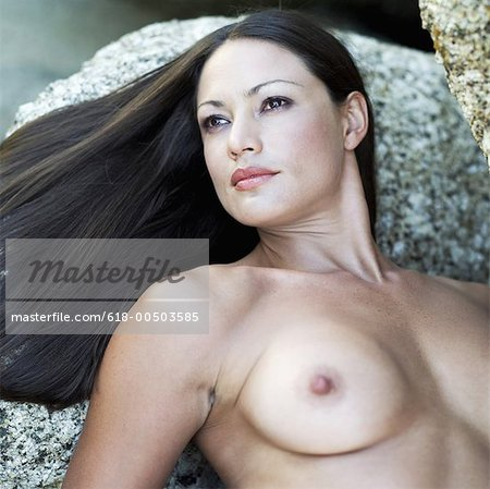 Nude Young Woman Lying On A Rock Stock Premium Royalty Free