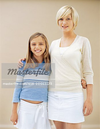portrait of a teenage girl standing with her mother Stock Photo - Premium Royalty-Free, Image code: 618-00663123