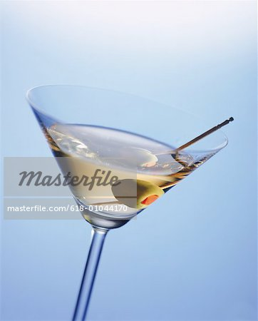 Martini glass with cocktail stick and green olive, close-up Stock Photo - Premium Royalty-Free, Image code: 618-01044170