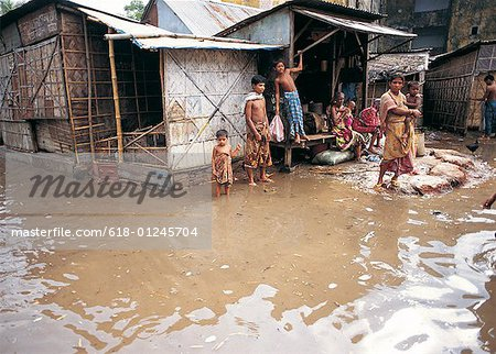 Floodwaters surrounding houses in Dhaka,Bangladesh Stock Photo - Premium Royalty-Free, Image code: 618-01245704